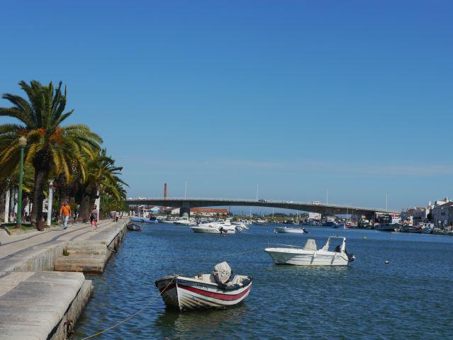 BOATS ON RIVER IN TAVIRA ALGARVE PORTUGAL